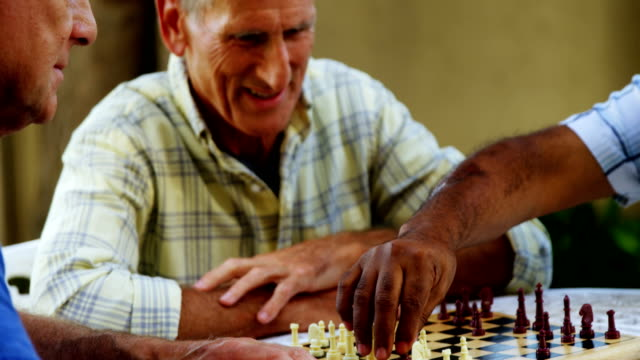 Senior friends playing chess 4k video