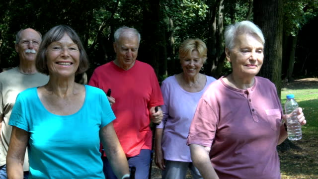 Senior friends talking while walking at park video