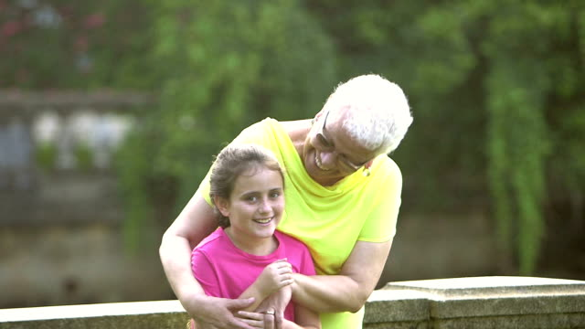 Senior Hispanic woman in park with granddaughter video