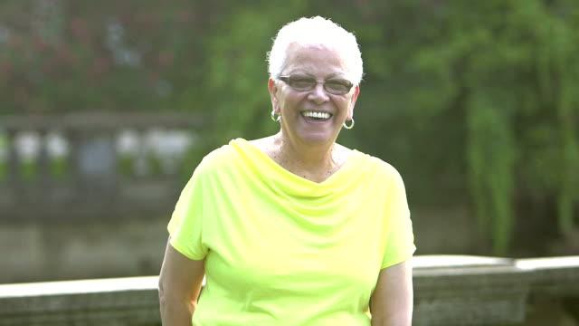 Senior Hispanic woman standing in park video