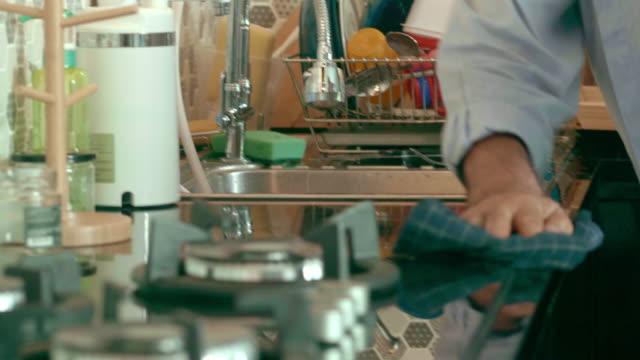 Senior In Kitchen Rag chores stock videos & royalty-free footage