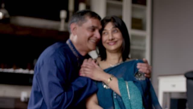 senior indian couple laughing together - sari filmów i materiałów b-roll