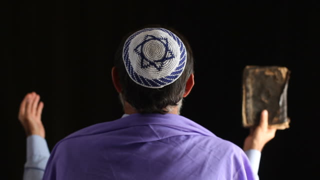 Senior jewish man praying ,holy book in hand video