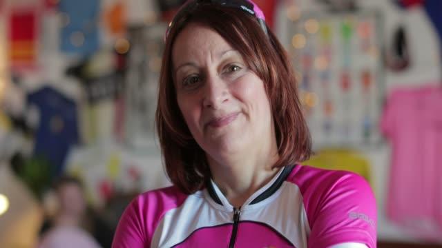 Senior Lady Cyclist Portrait A video of a senior lady cyclist portrait inside of a cafe. 50 54 years stock videos & royalty-free footage