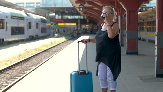 senior lady väntar på ett tåg - waiting for a train sweden bildbanksvideor och videomaterial från bakom kulisserna