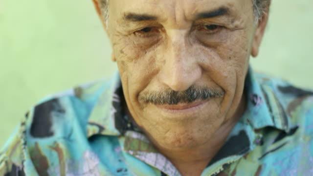 Senior latino man smiling video