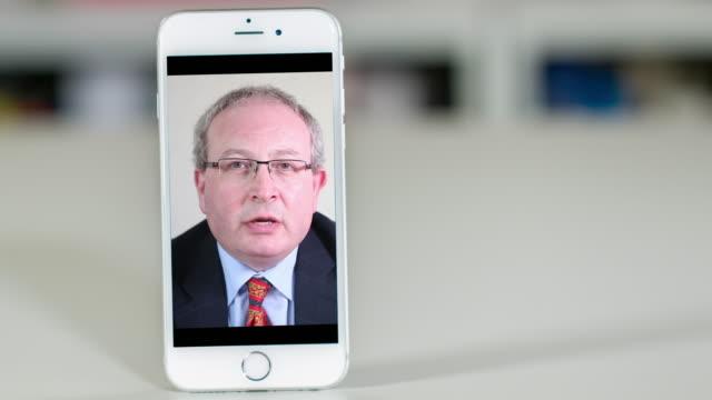 Senior lawyer consultation on smart phone video