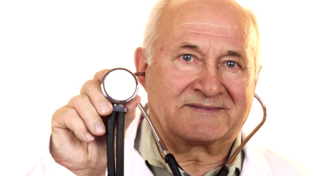 Senior male doctor holding up a stethoscope to the camera video