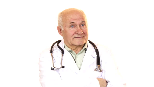 Senior male doctor with a stethoscope smiling to the camera video