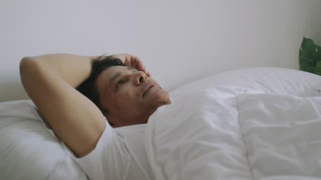 Senior man cannot sleep. Non-Caucasian only, Senior people, Senior Thai adult, illness, males, men, sadness, worried, insomnia stock videos & royalty-free footage