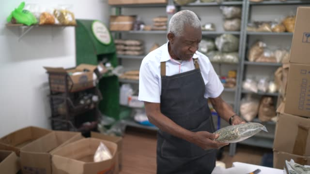 Senior man checking the storage room of a natural products shop