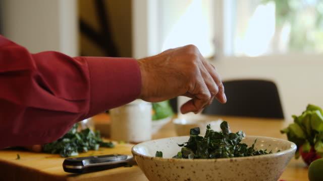 Senior man chopping chard at home