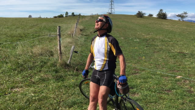 Senior Man Cycler Taking a Break and Enjoying Landscape video