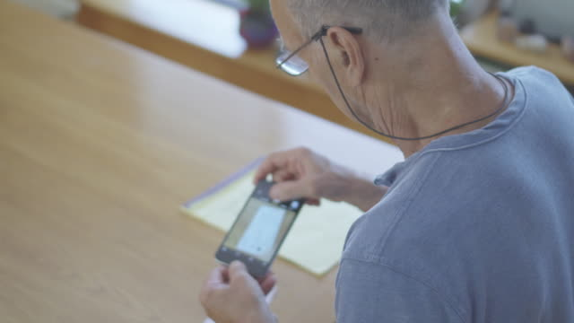Senior Man does Online Banking