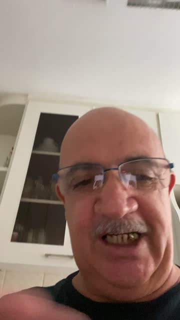 Senior man doing a video call at home - pov of mobile camera video