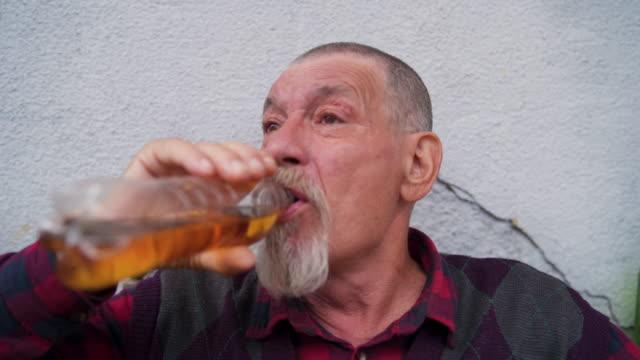 senior man drinking brandy - brandy video stock e b–roll