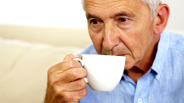 Senior man drinking coffee video