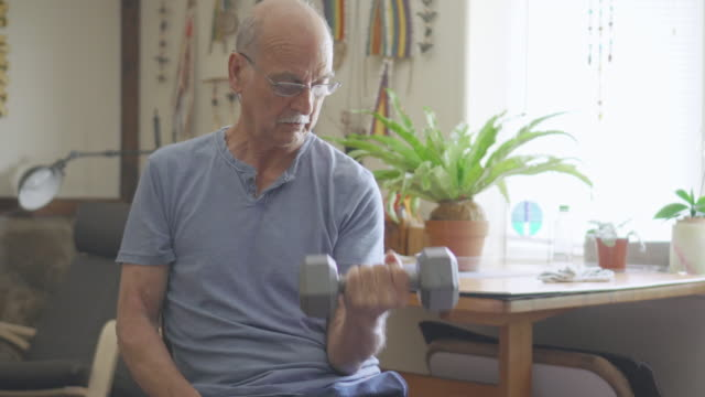 Senior Man Exercising with Dumbbells video
