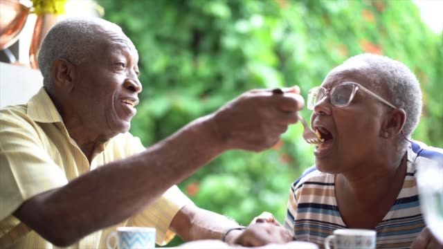 Senior man feeding his wife during afternoon tea video