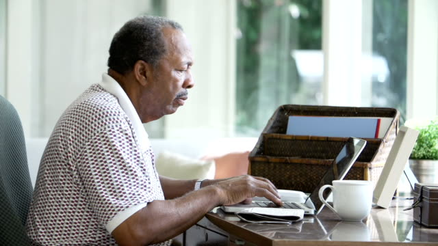 Senior Man Finding Phone Number Of Company Online video