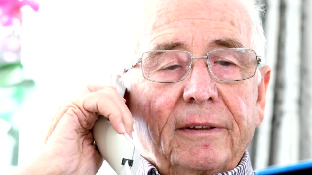 Senior Man Giving Credit Card Details On The Phone video