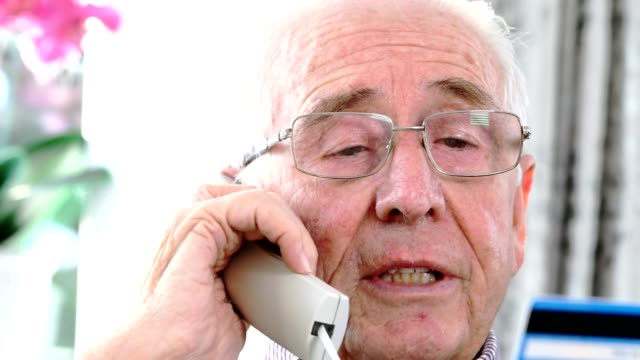 senior man giving credit card details on the phone - fraud stock videos & royalty-free footage