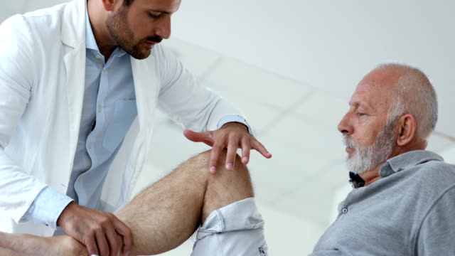 senior man having medical exam. - fisioterapia video stock e b–roll