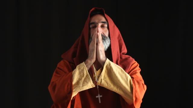 Senior Man In Medieval Priest Costume Praying video