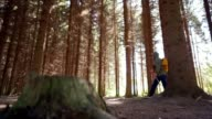 istock Senior man is hiking in the forest 1277755982