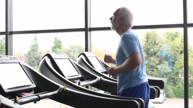 Senior man jogging on treadmill video