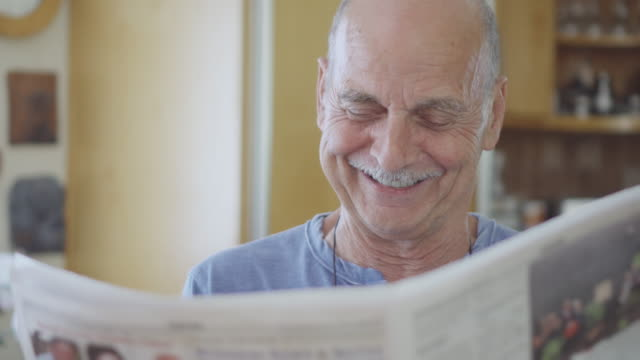 Senior Man Laughing While Reading the Newspaper video
