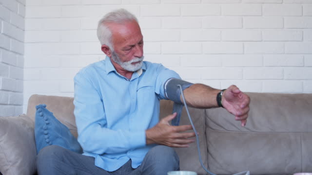 Senior man measure his blood preassure Senior man measure his blood preassure blood pressure gauge stock videos & royalty-free footage