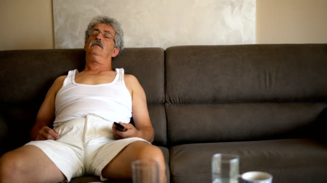 Senior man napping on couch video
