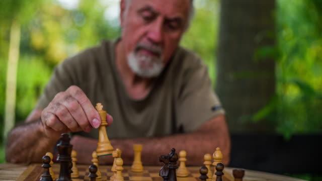 Senior man playing chess video