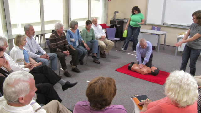 HD: Senior Man Practicing CPR On A Dummy video