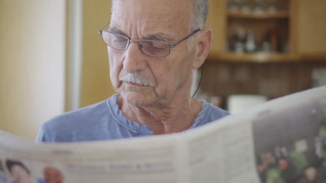 Senior Man Reads the Newspaper video