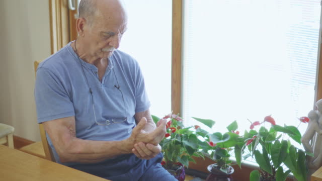 Senior Man Rubbing his Painful Hands video