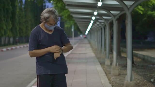 Senior Man Run And Setting Smart Watch Slow Motion