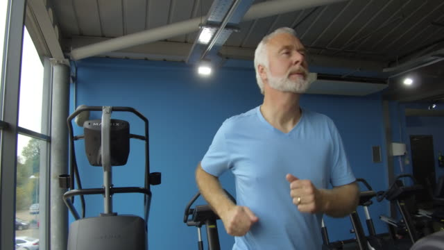 Senior man running on a treadmill video