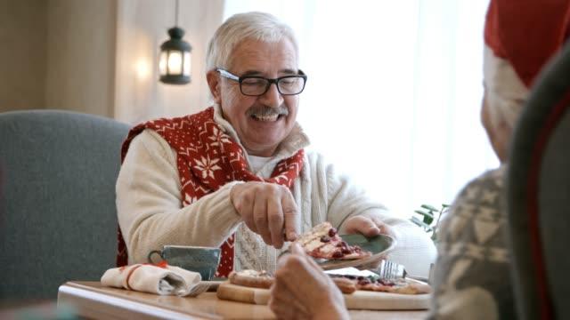 Senior Man Serving Christmas Pie for Wife at Dinner in Restaurant video