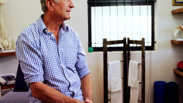 Senior man sitting in clinic 4k video