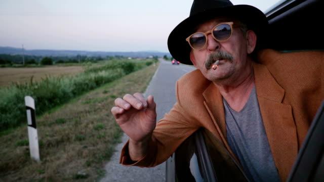 Senior man smoking joint