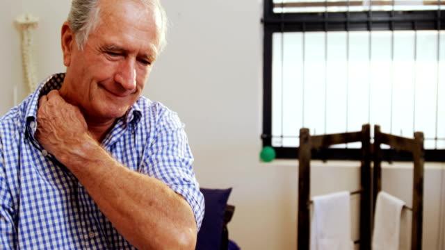 Senior man suffering from neck pain 4k video