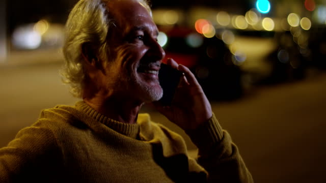 Senior man talking on mobile phone in the city 4k Active senior man talking on mobile phone in the city 4k 50 59 years stock videos & royalty-free footage