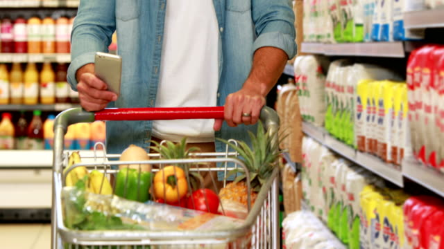 Senior man texting in the supermarket video