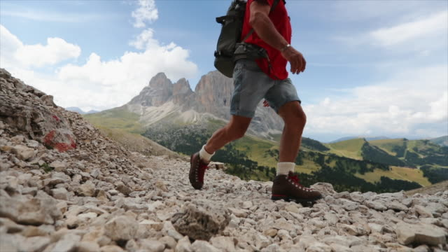 Senior man trail hiking on the Dolomites video