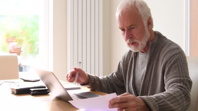 Senior man using laptop computer video