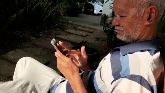 Senior man using smartphone video