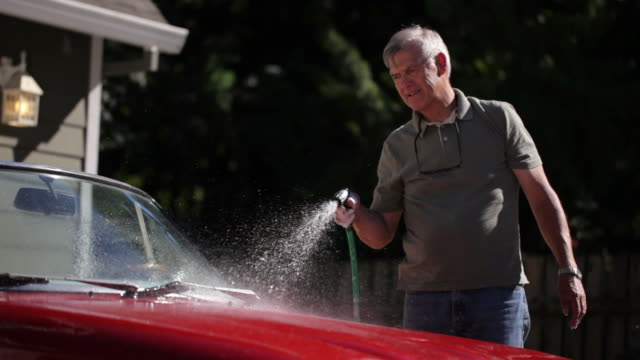 Senior man washing car video