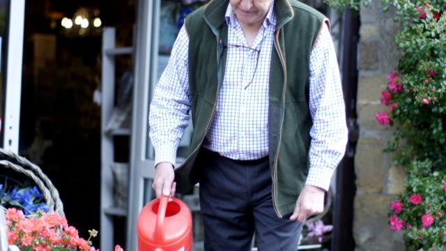 Senior Man Watering Plants video